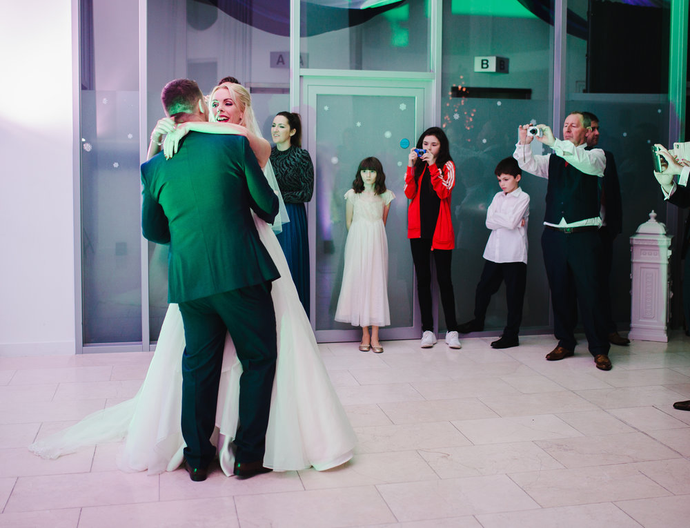bride and groom dancing at Liver Building; wedding venue of the picking