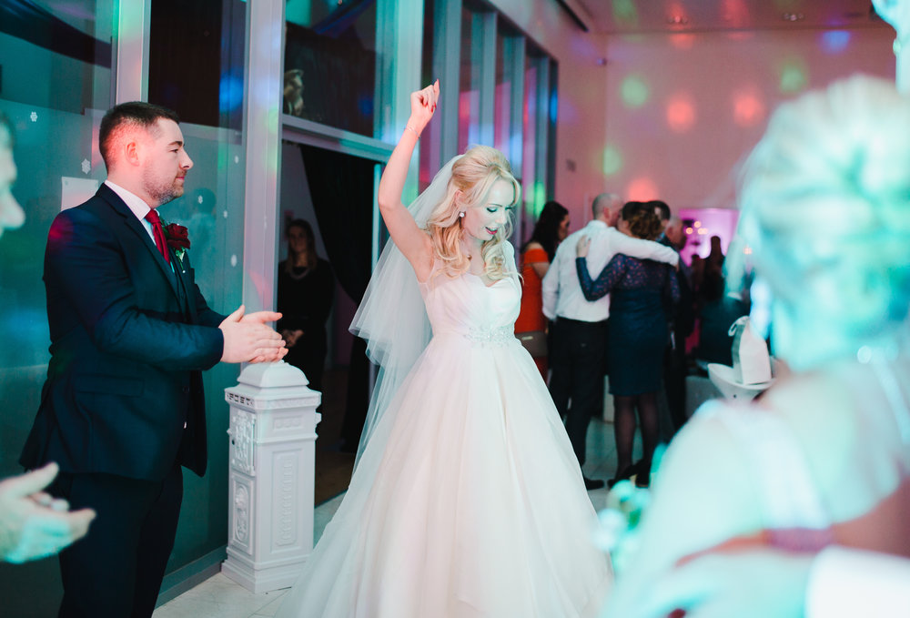 the bride with hands in the air on the dance floor- documentary wedding photos