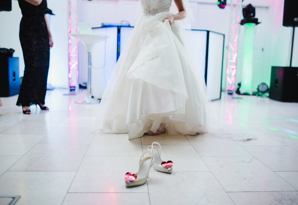 The shoes are of from the bride as she dances away- Creative wedding photography