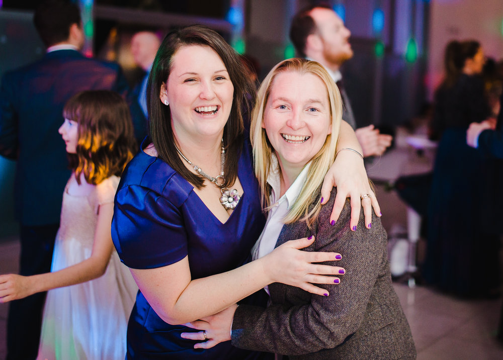 smiles from wedding guests at the liver building in liverpool- North west wedding photography, documentary styled