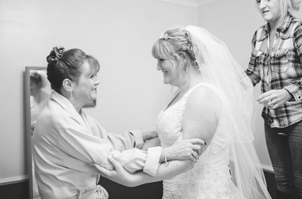 The bride and her mother hand in hand, black and white photo- Creative wedding photography