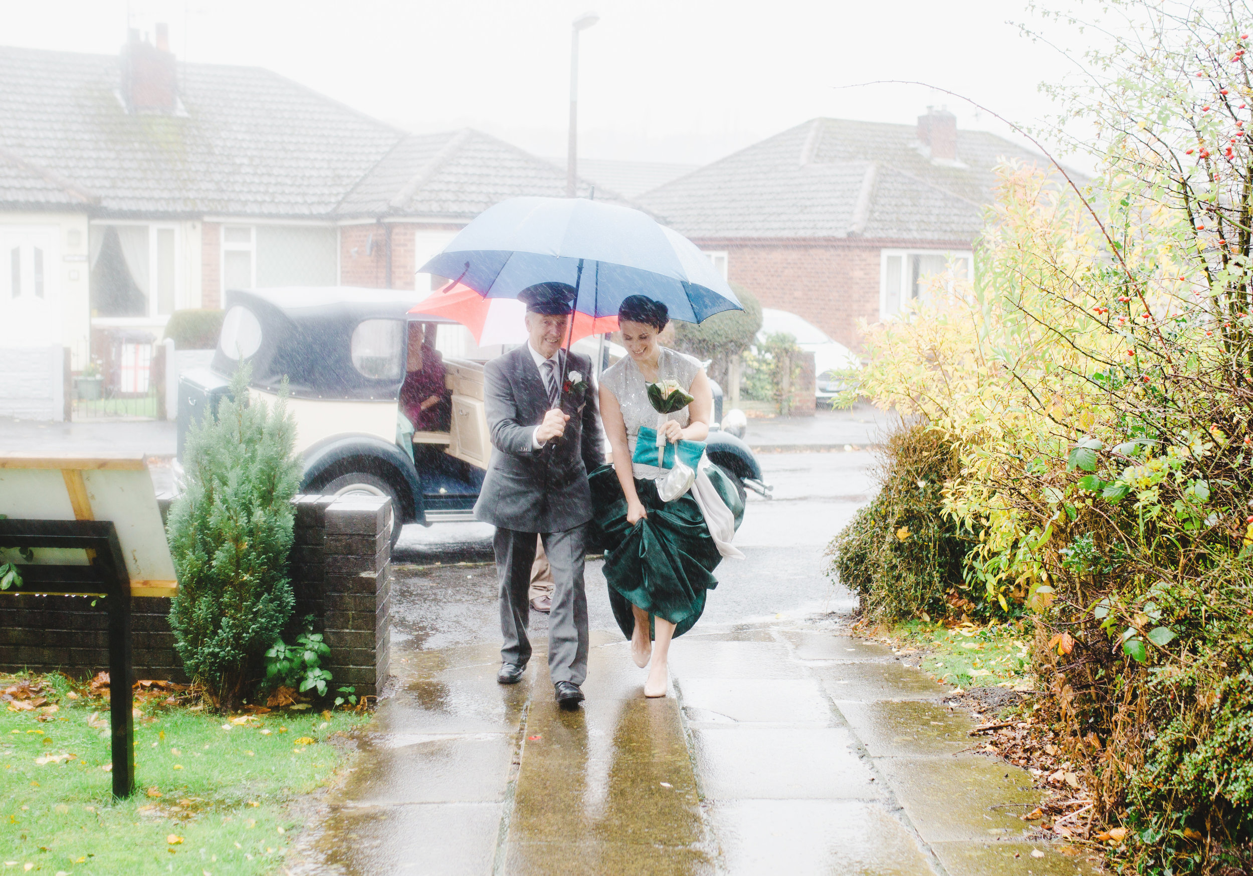 rainy wedding day pictures - arriving at church
