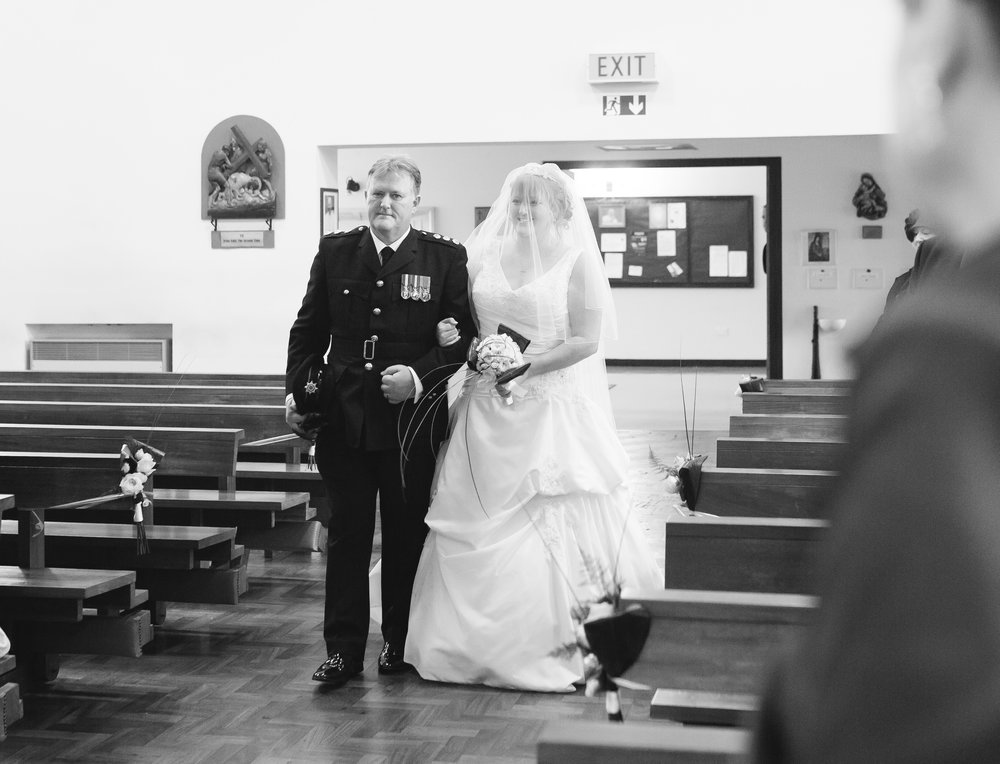 The bride walking down the aisle with her father- Lancashire wedding photographer