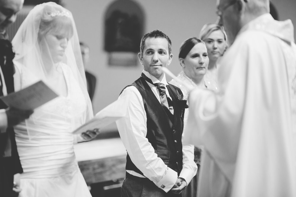 Black and white photograph of the bride reading her vows to her groom- Documentary photography