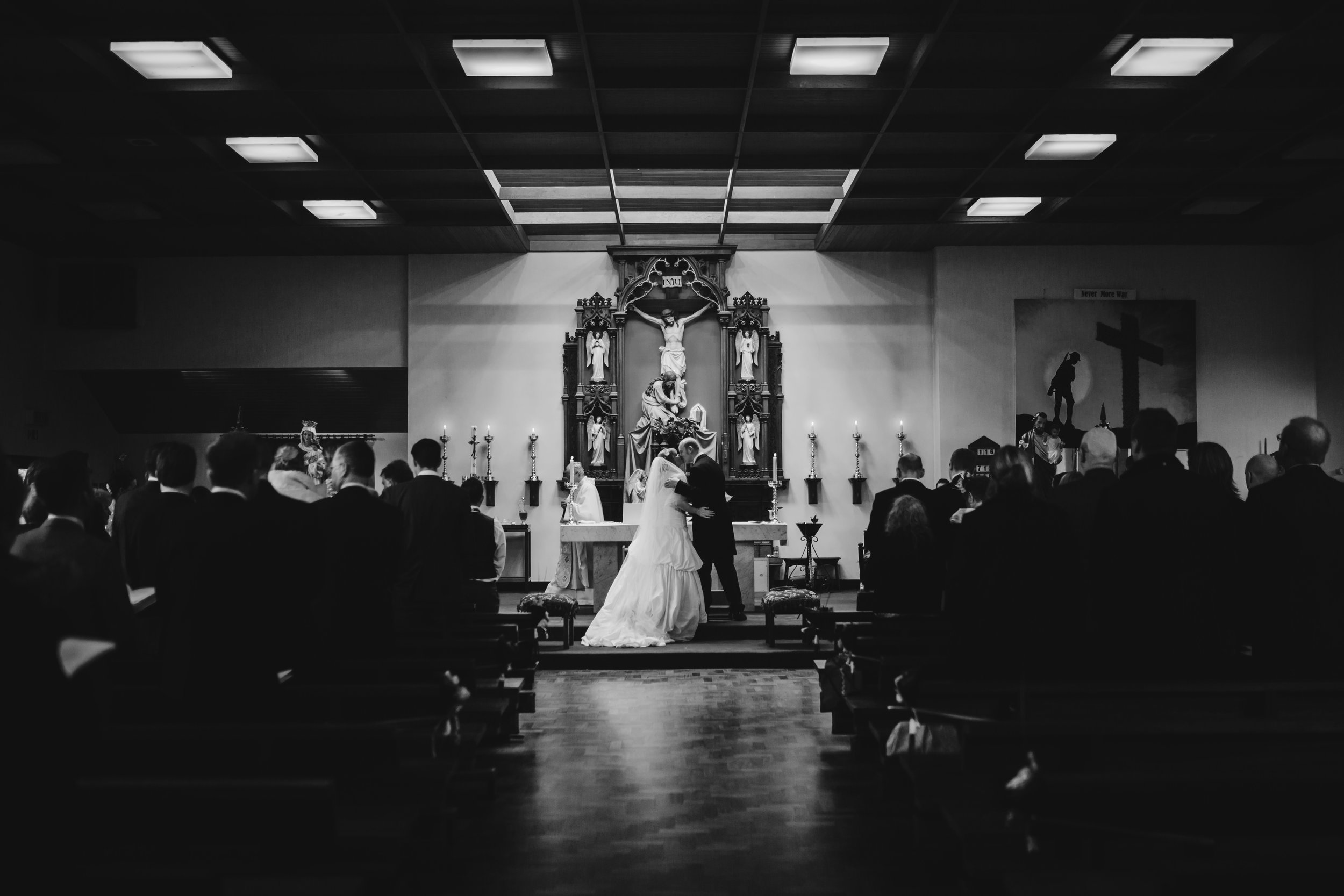 Creative wedding photography - black and white first kiss picture
