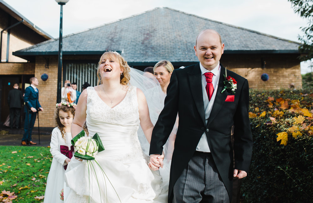 Big smiles from the bride and groom at Spread Eagle- Ribble Valley wedding in lancashire