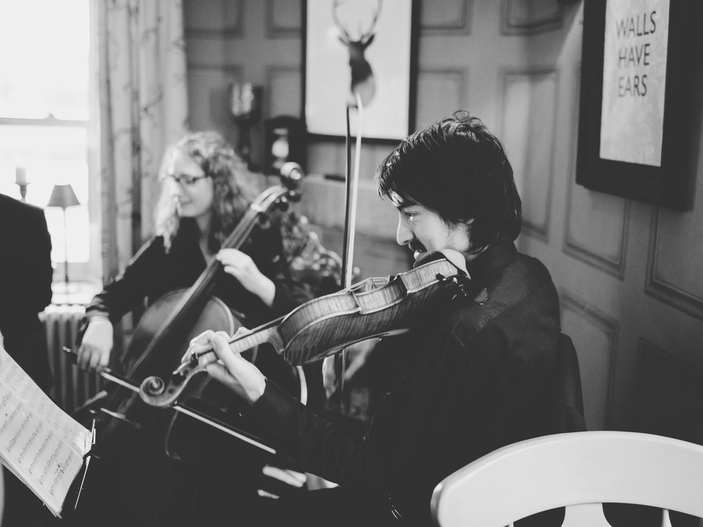 Black and white photograph of the musician playing at Spread Eagle- Relaxed wedding photographer