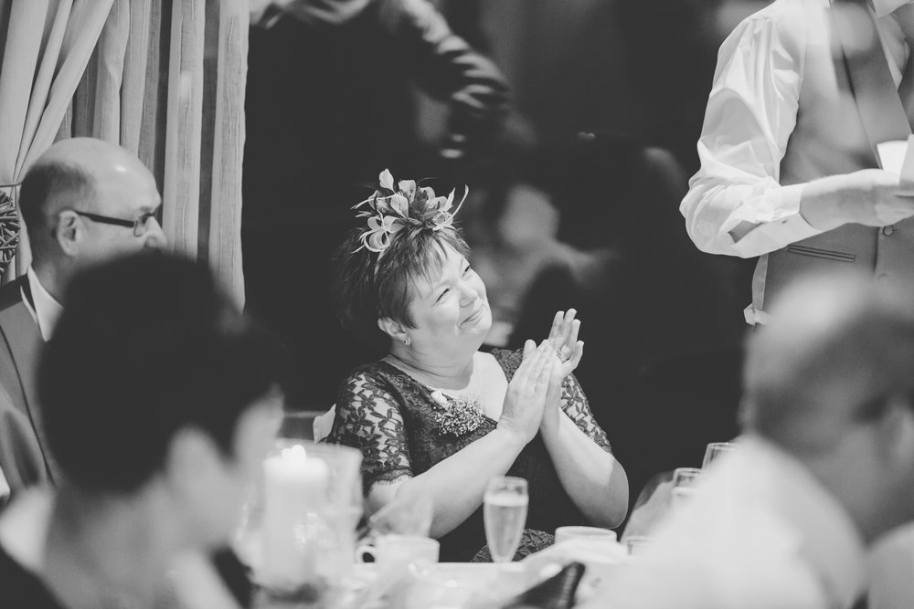 Clapping from wedding guests as the bride and groom enter the room- Documentary wedding photography