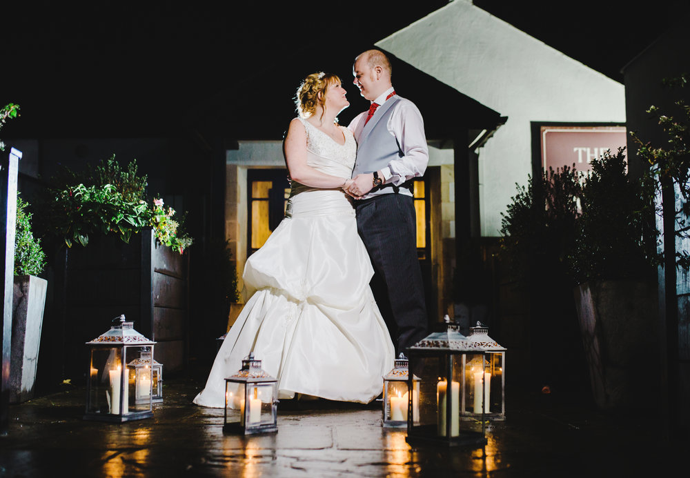 The bride and groom outside Spread Eagle as it is dark- Creative wedding photography