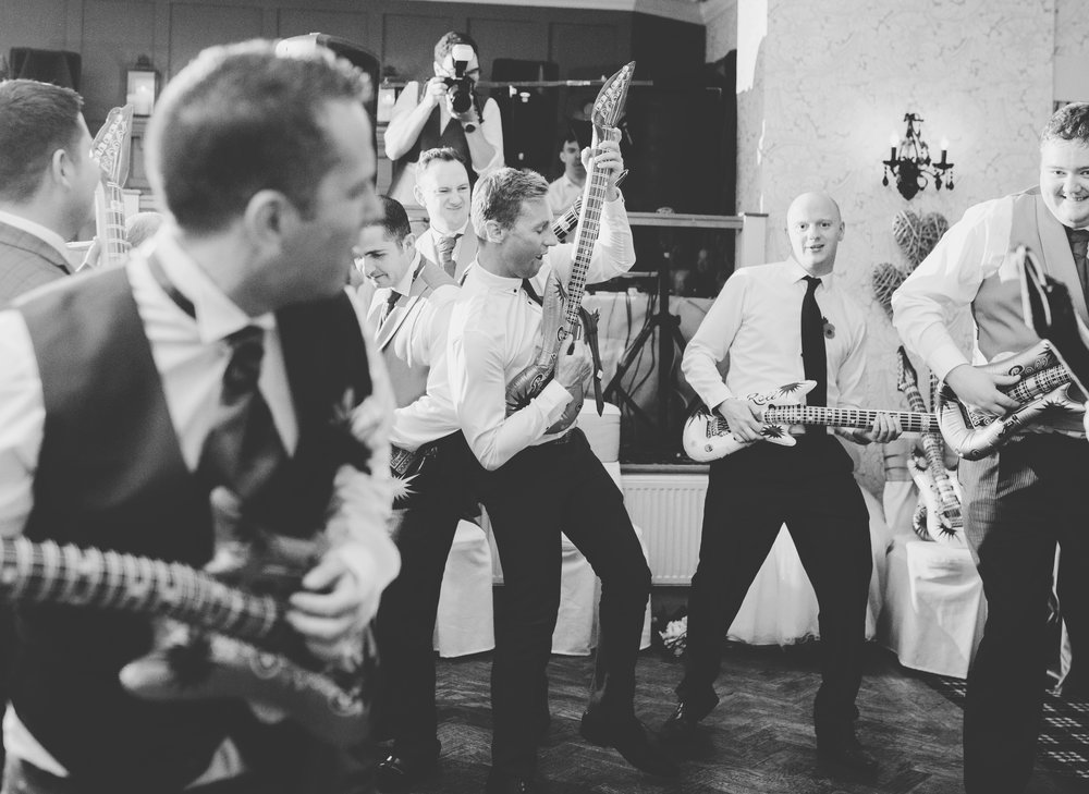 Black and white photograph of wedding guests on the dance floor- Lancashire wedding photographer