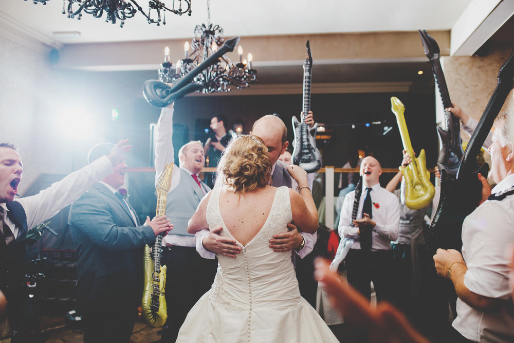 The bride and groom kissing on the dancefloor- photography documentary style photography