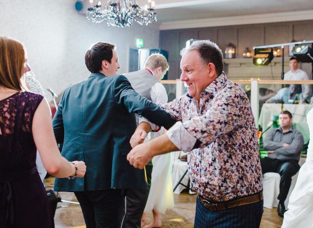 Documentary wedding photograph of wedding guests dancing- Relaxed fun wedding