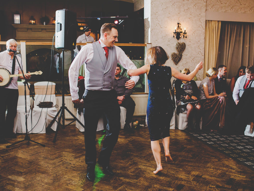 Dancing on the dance floor for some wedding guests- Documentary wedding photograph in the ribble valley, lancashire