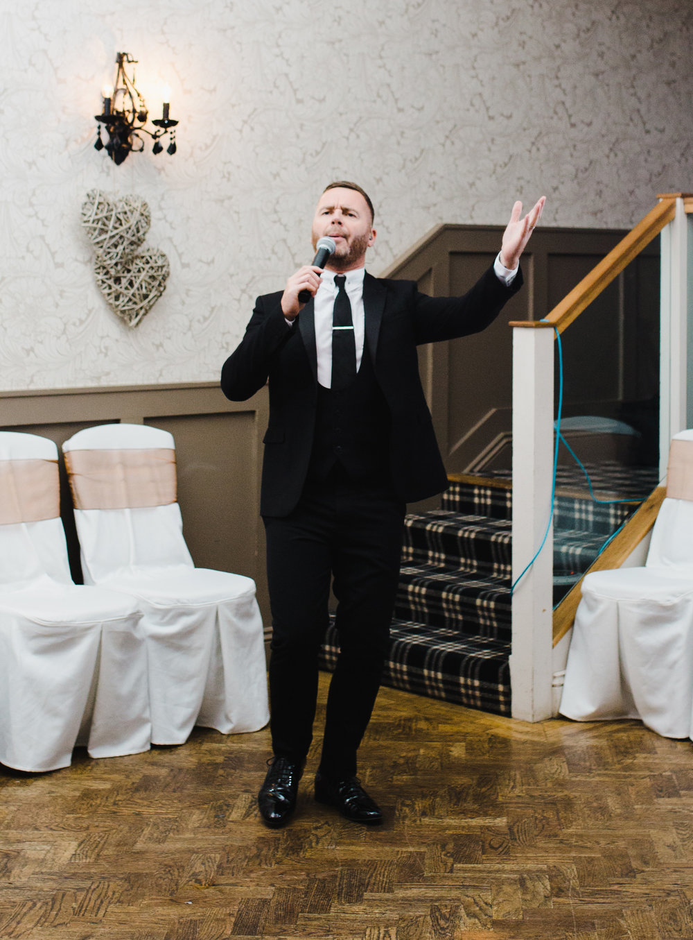 one of the wedding guests singing of the bride and groom- Ribble valley wedding in lancashire, Spread Eagle
