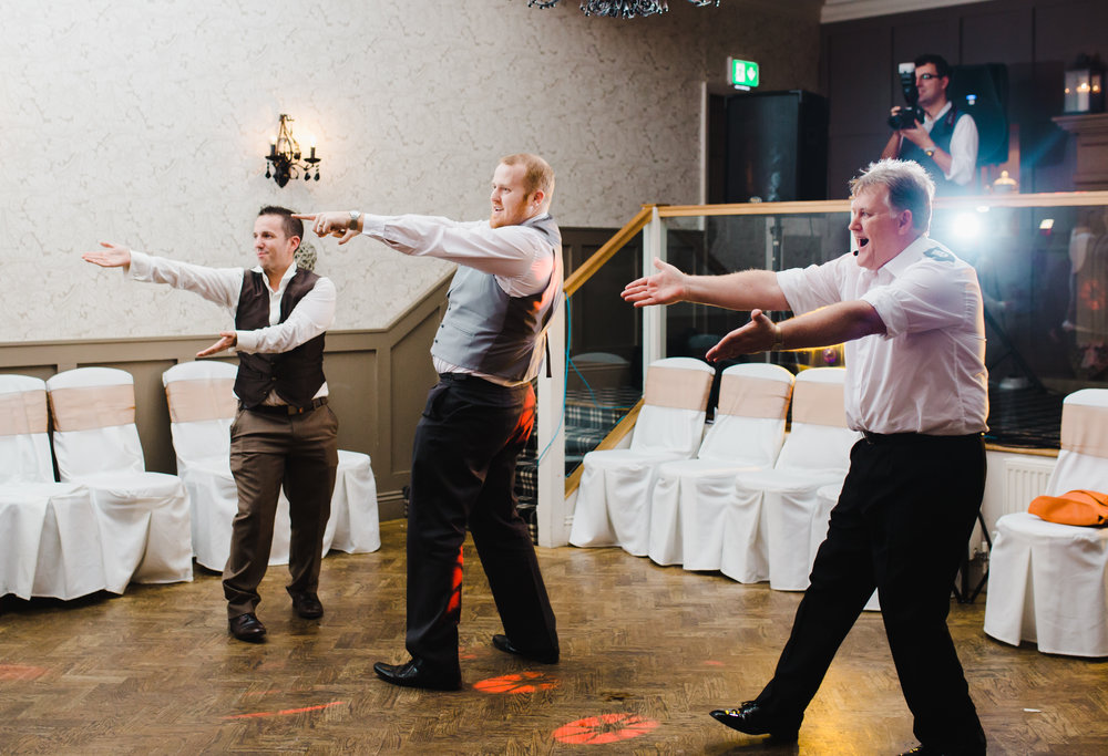 Dancing from the groomsmen and groom- Creative fun wedding photography