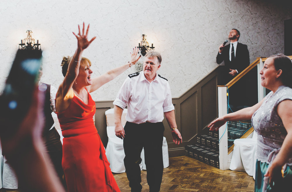 Hand in the air form the wedding guest at Spread Eagle Wedding venue