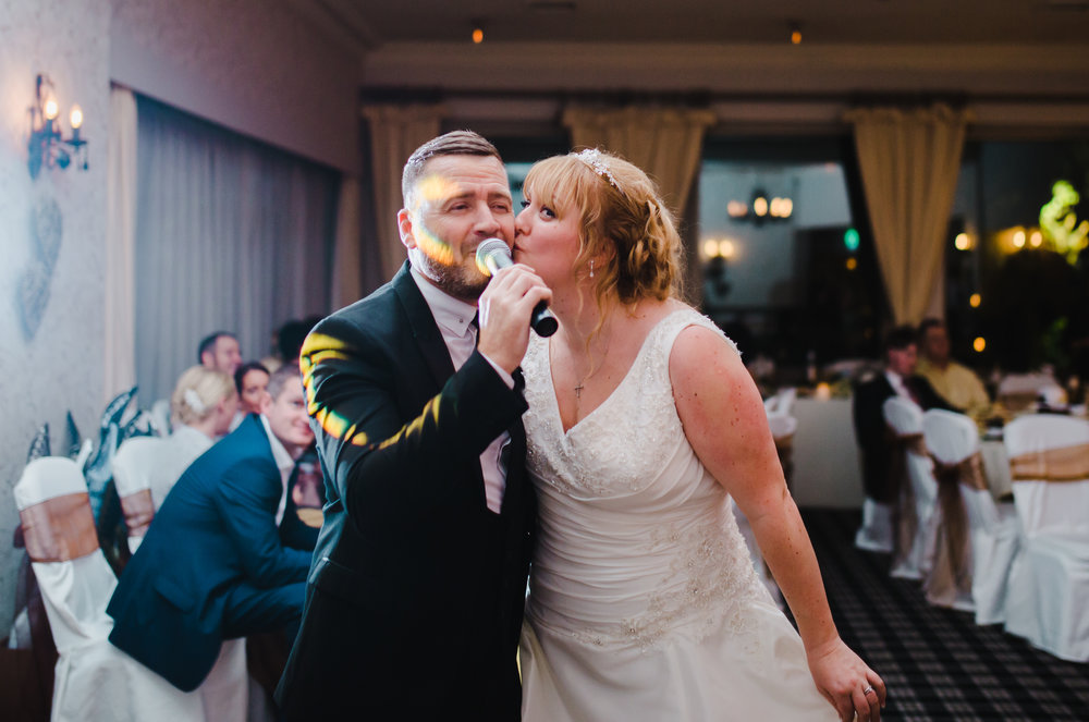 The bride singing with the wedding singer- Creative fun wedding photographer in lancashire