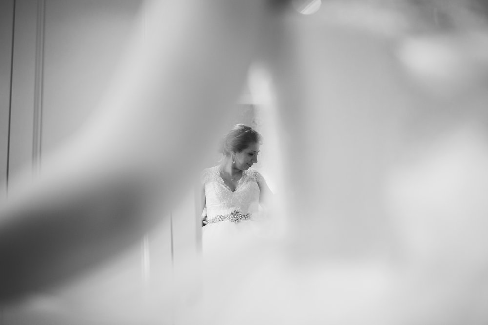 creative photogprah of the bride photo through the mirror- Creative wedding photography lancashire