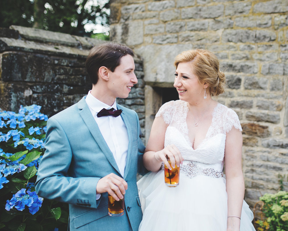 The bride and grooms hair filled with confetti petals- Fun relaxed wedding in the north west