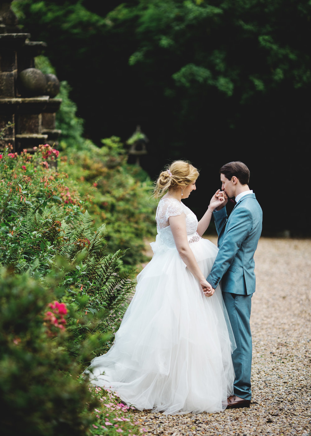 the bride and groom portrait on the pathway at Houldsworth House- Creative wedding photography