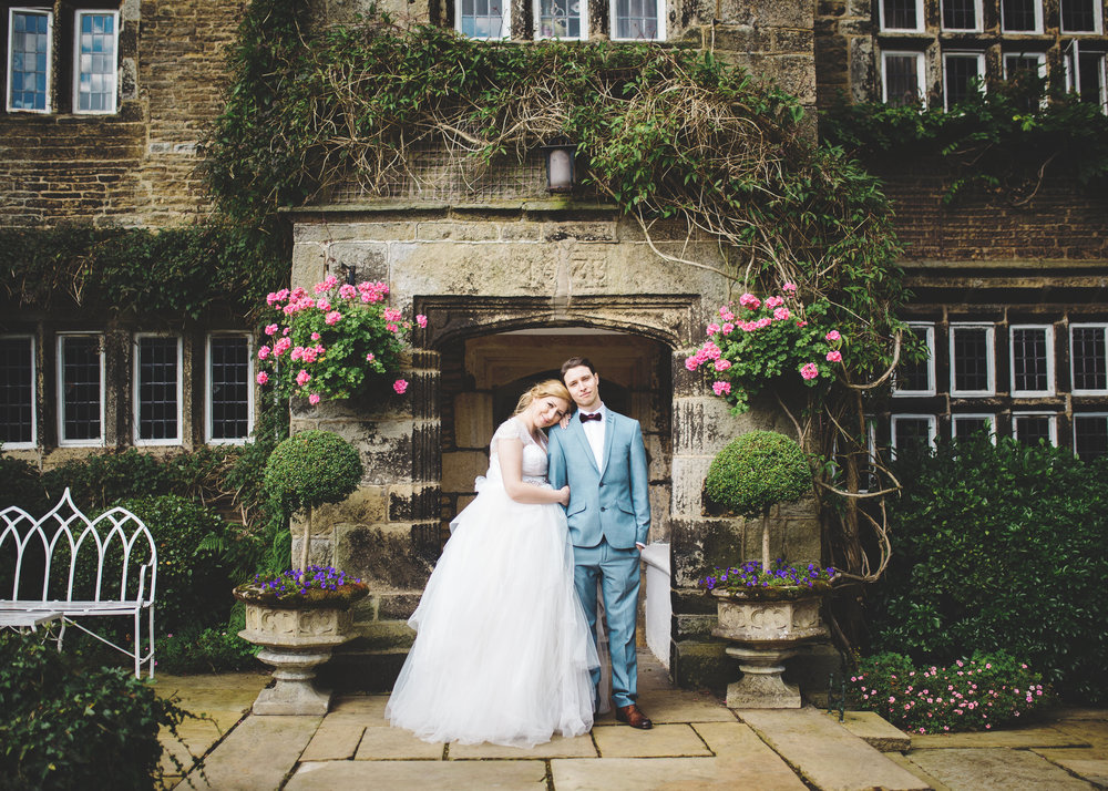 The bride and groom stood outside of Houldsworth House, Houldsworth House as a wedding venue