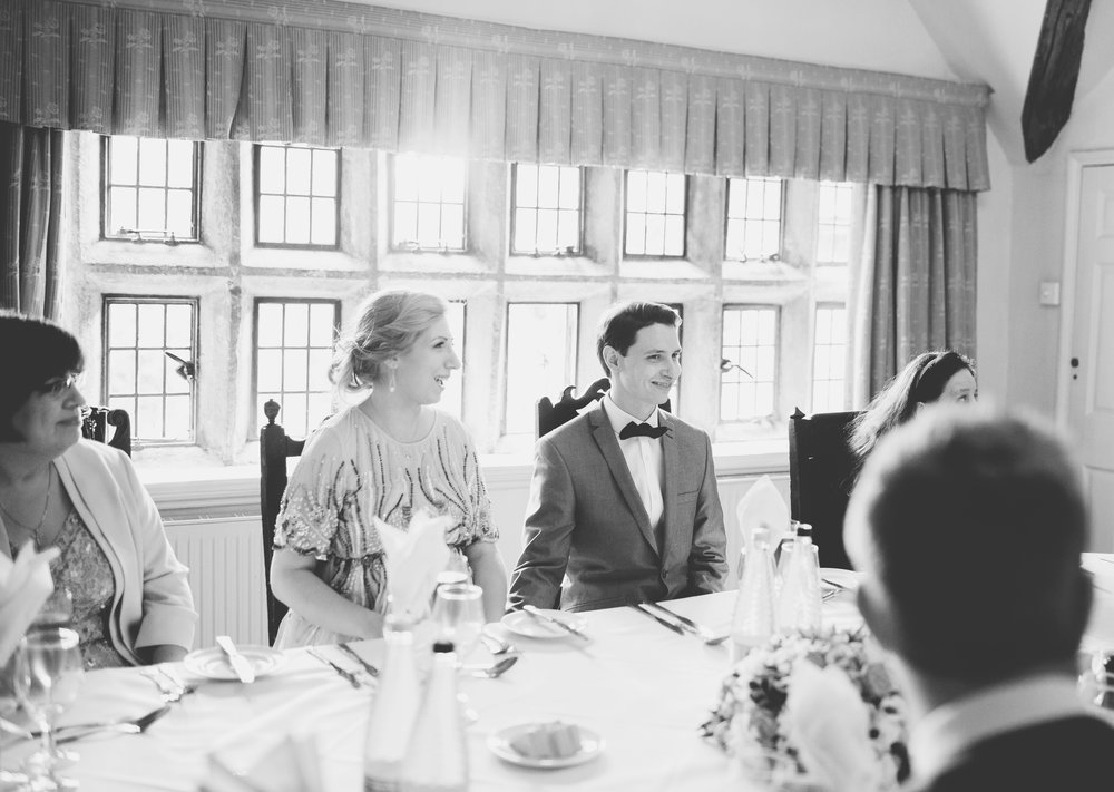 The bride and groom sat at their table- documentary wedding photography