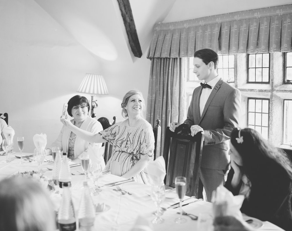 Black and white photograph of the groom saying his speech- North west creative wedding photographer