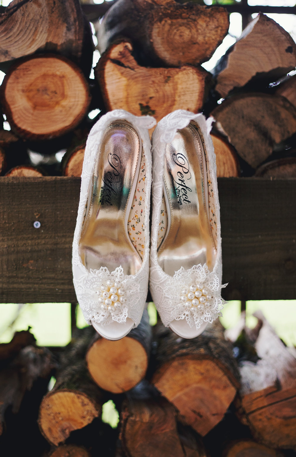 The bridal shoes on wooden logs- Cheshire wedding