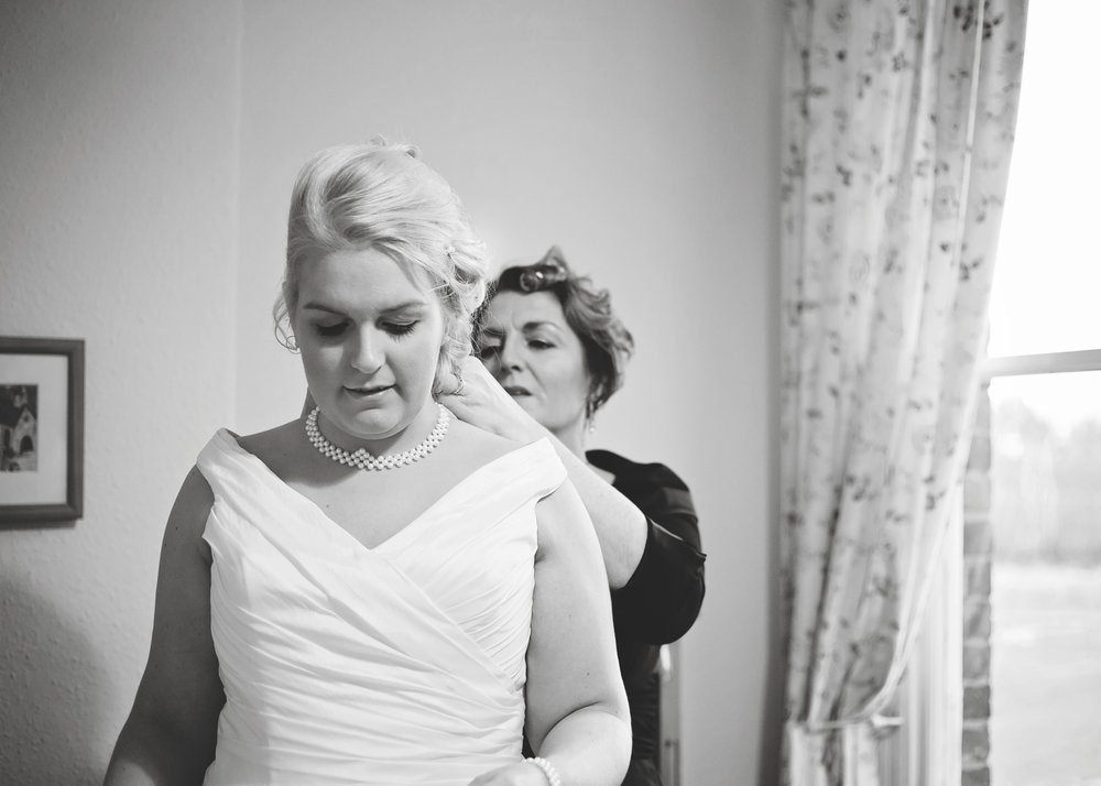 The bride having her necklace put on- Wedding in Cheshire