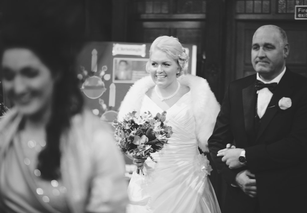 The bride about to walk down the aisle at Cheshire- Creative documentary styled wedding photography
