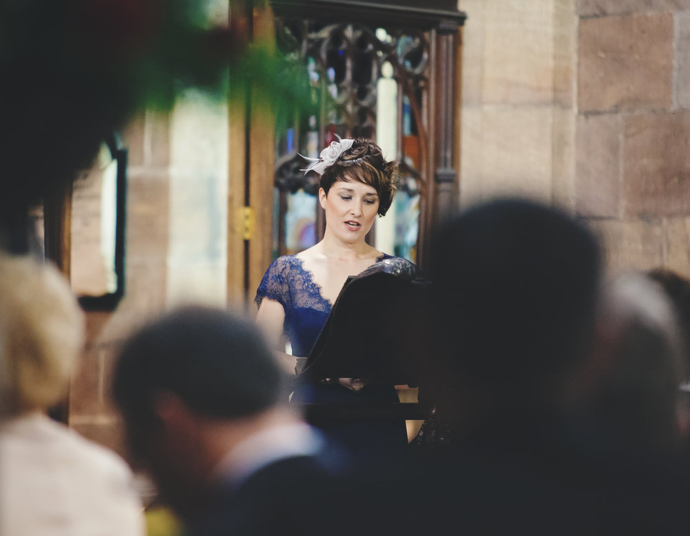 one of the wedding guests saying a few words at manchester town hall- Lancashire wedding photographer in Cheshire