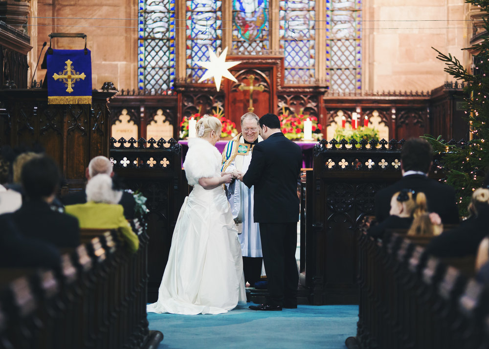 The bride and groom at the alter- Documentary wedding photography in Cheshire