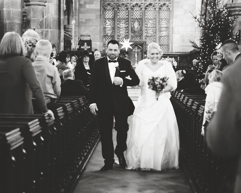 The bride and groom walking back down the aisle at Manchester Town Hall- Creative wedding photography in Cheshire