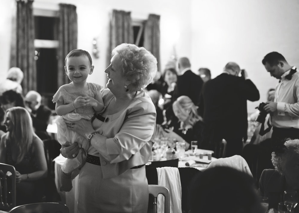 Black and white photograph of the wedding guests- Documentary wedding photography in Cheshire, Lancashire