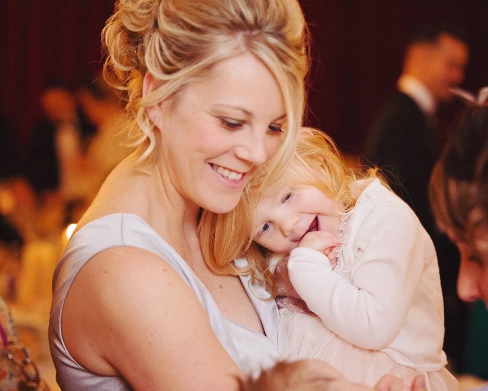 The bride and one of the young guests- Documentary wedding photography