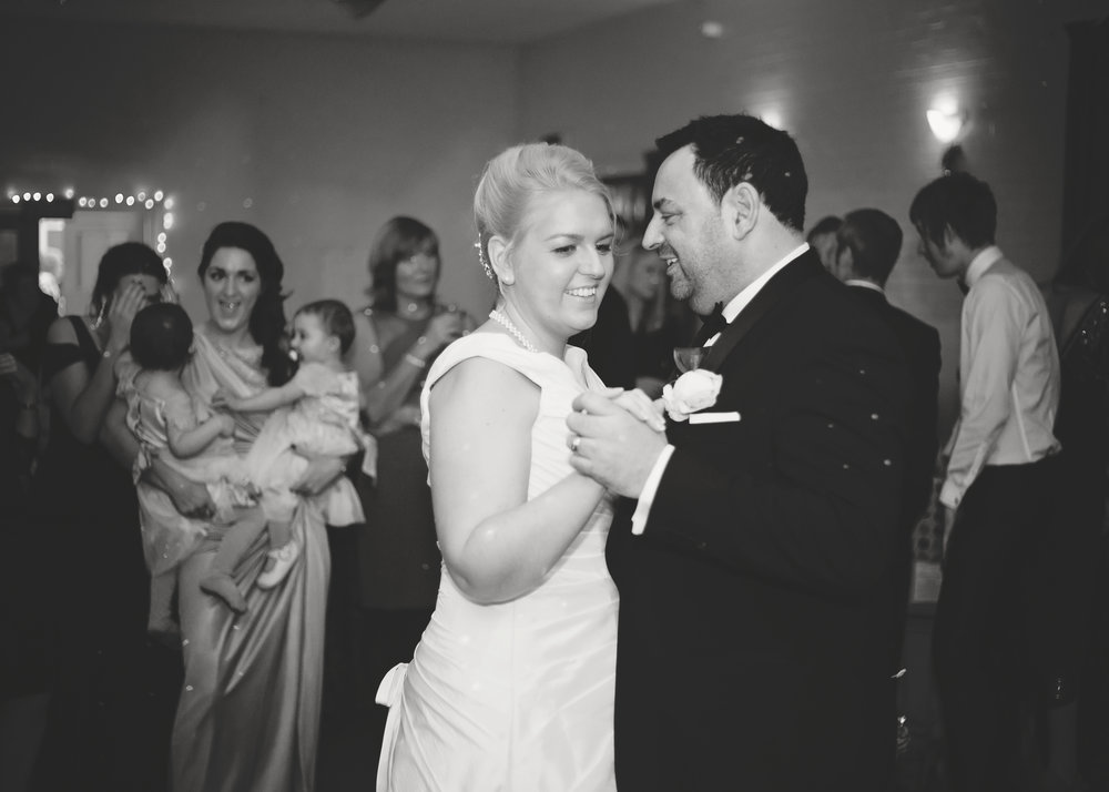 Black and white photograph of the bride and grooms first dance- Documentary wedding photography