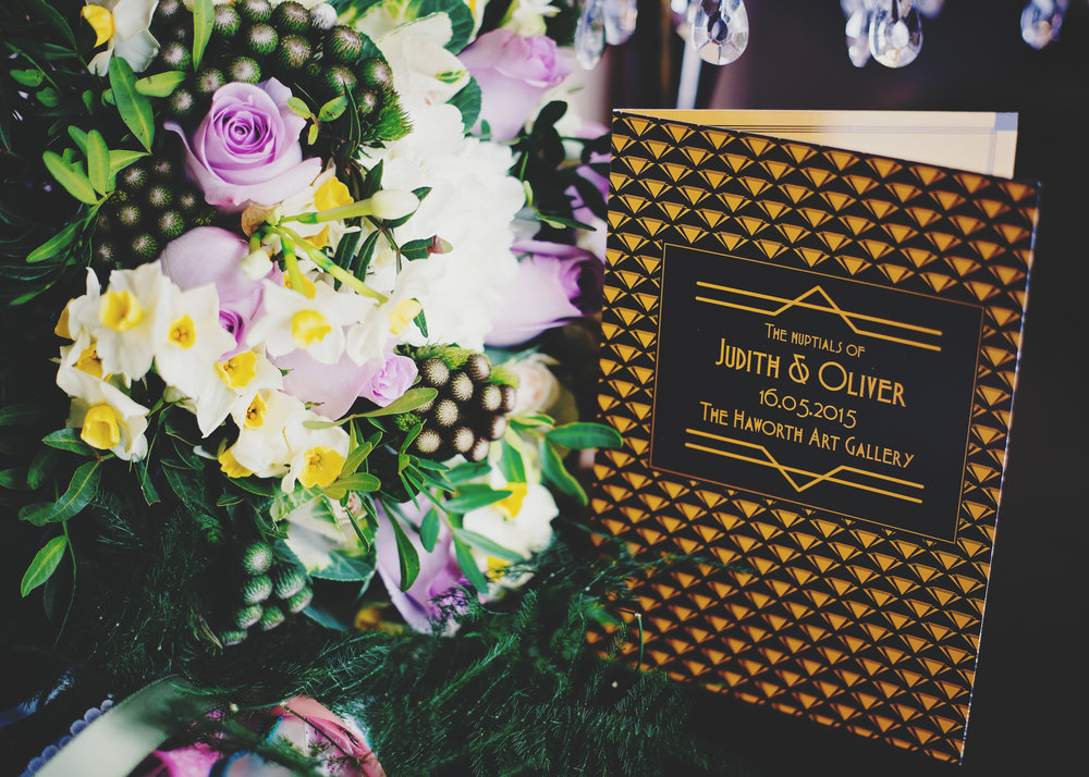 The wedding invitations next to the wedding bouquet- Lancashire wedding photographer