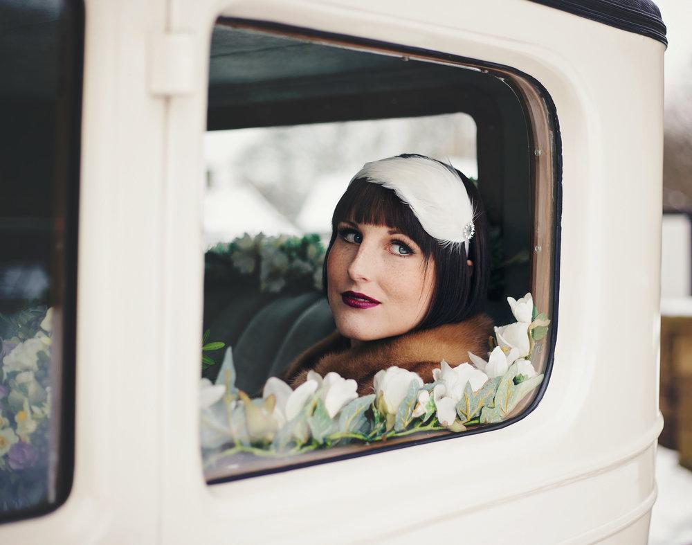 The bride sat inside the wedding car- 1920 themed wedding in lancashire, Haworth Art Gallery