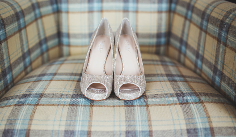 The bridal shoes for the wedding gat the Lake district, Inn on the Lake- Creative wedding photography