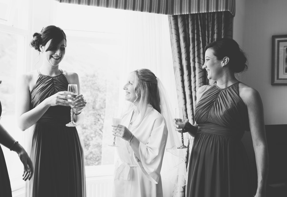 Black and white photograph of the bride and her bridesmaids