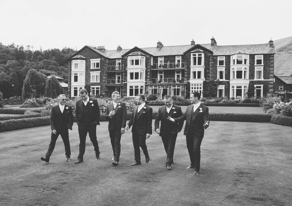 Black and white photography of the groom and groomsmen