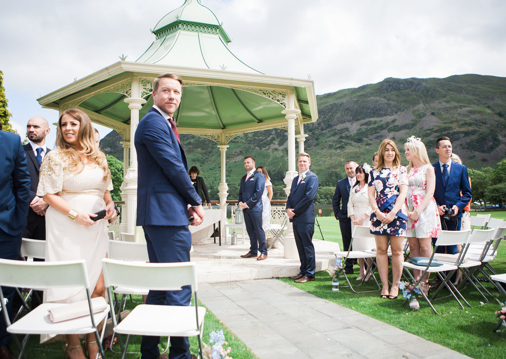 An outdoor wedding filled with wedding guests at the lake district- photographer at Inn on the Lake