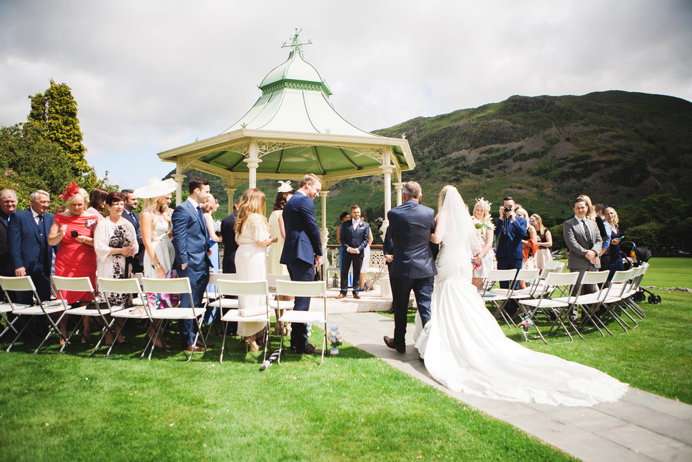 The bride getting the groom at the alter at the outdoor wedding- Creative wedding photography in the lake district