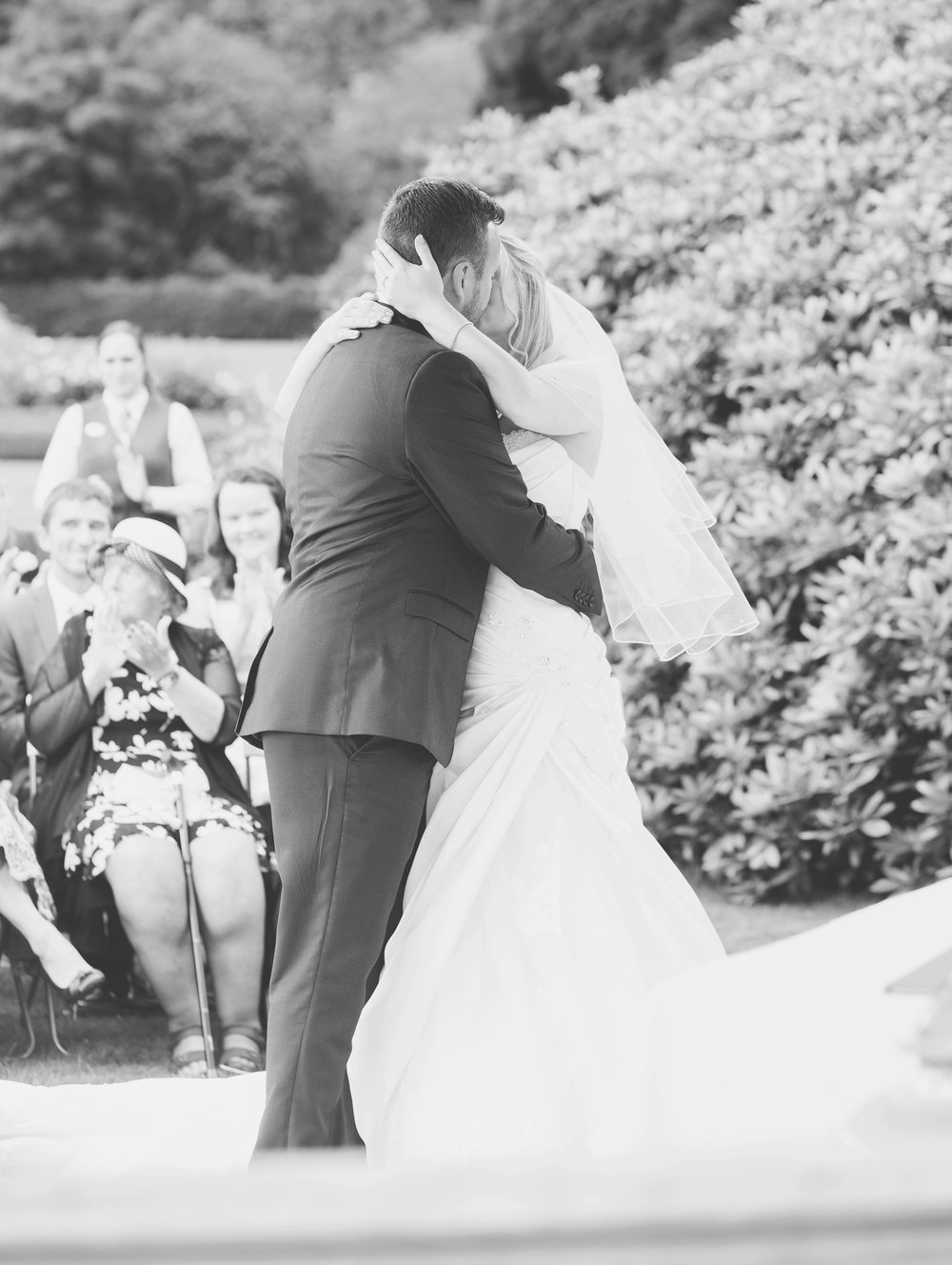 The bride and groom kissing at Inn on the Lake for their wedding- Relaxed wedding photographer