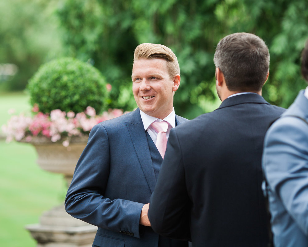 One of the smiling wedding guests- Outdoor themed wedding at the lakes photography