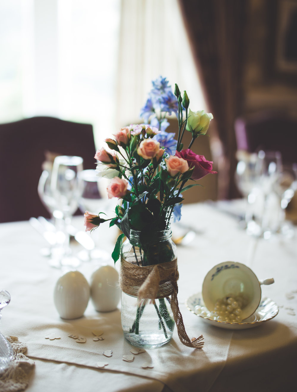 Colourful table flowers at the lake district- Colourful wedding photographer