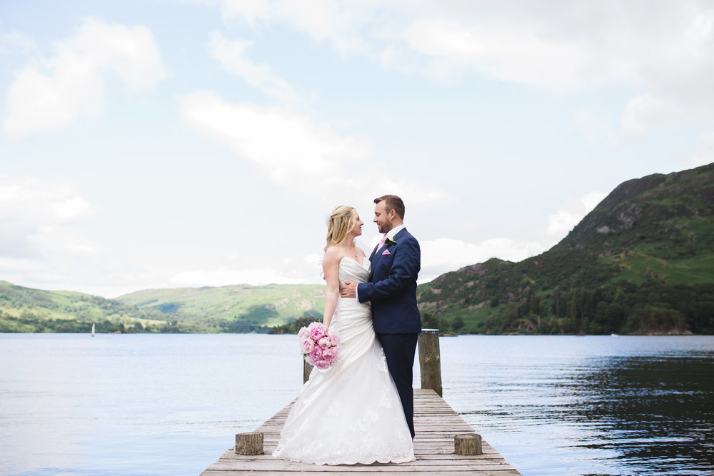 the bride and groom on the bridge at the lake district- creative wedding photography