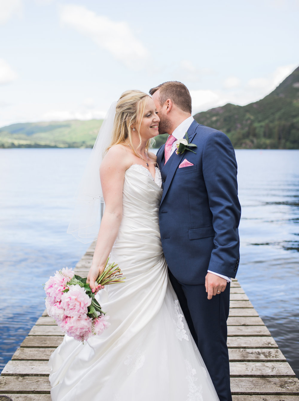 Portrait of the bride and groom outside of the Inn on the Lake- Creative wedding photographer