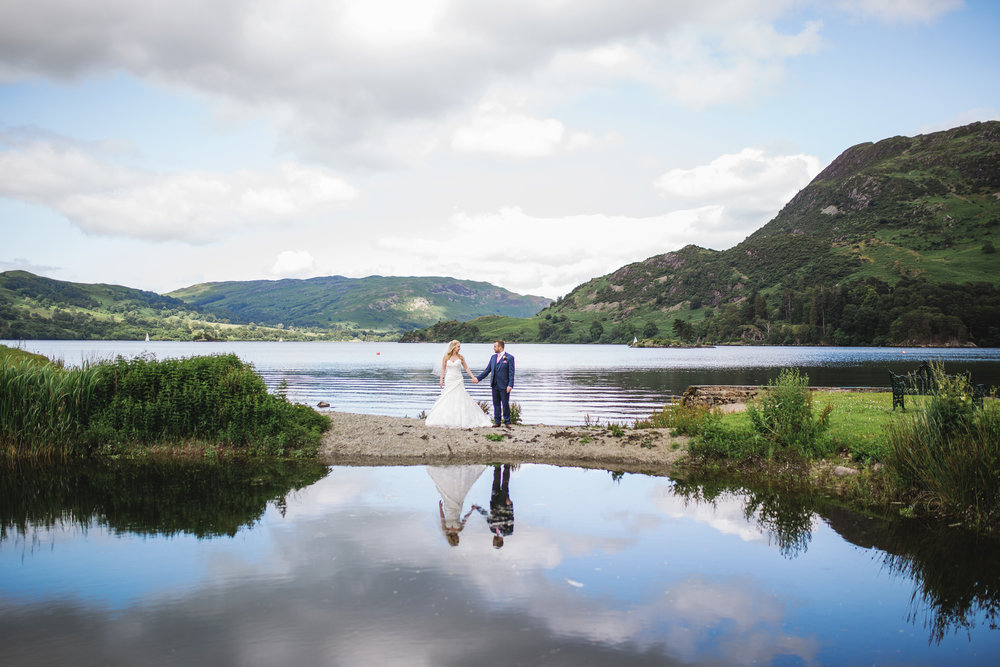 Landscape of the Lake district featuring the bride and groom- Creative styled wedding photography