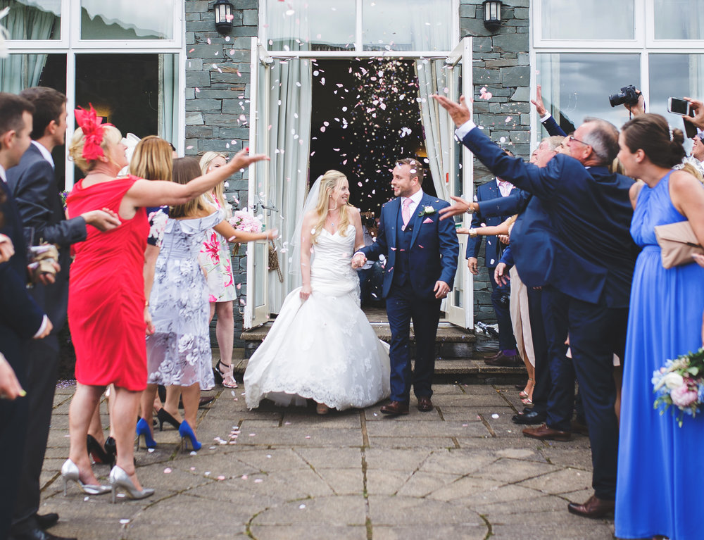 bride and groom walking through confetti- creative wedding photography